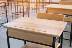 School empty classroom or lecture room interior with desks chairs iron wooden without young student and prepareing for test exam or studying lessons of secondary education. Back to school concept