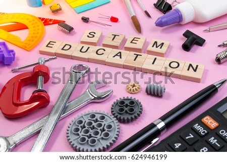 School equipment with word STEM Education over pink background in education STEM concept. School desk with stationery tools for STEM learning. #624946199