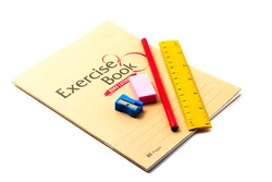School exercise-book with school stationery isolated on white background