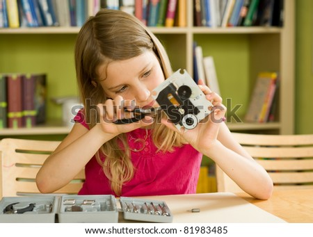 School girl busy with tools and mechanism