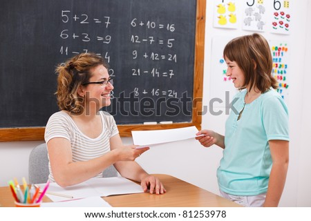 School girl giving or receiving math test paper