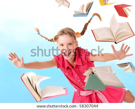 School girl  holding pile of books. Outdoor. - stock photo