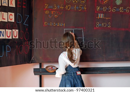 school girl on math classes finding solution and solving problems