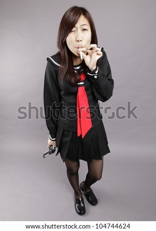 School girl plays cigarette and gun.