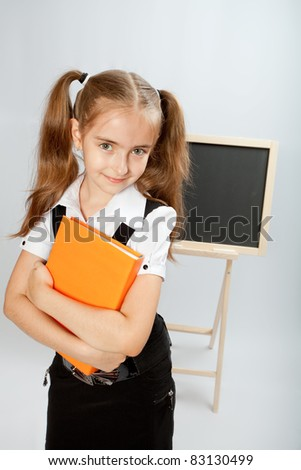 School girl with yellow book