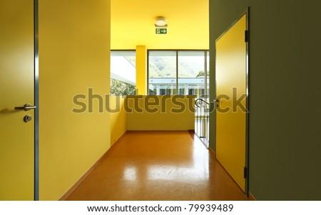 school hall with yellow doors