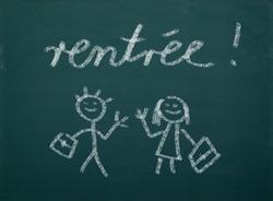 School kid's drawings on green blackboard, french writing