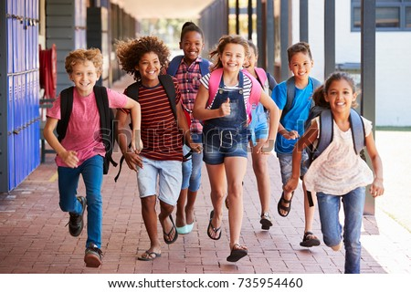 school kids running in...