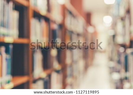 School library or study class room, education blur background with blurry view of books on bookshelves in classroom aisle for students and teacher academic educational data learning center