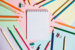 School notebook and pencils, on a multicolored background. Education concept. Back to school.