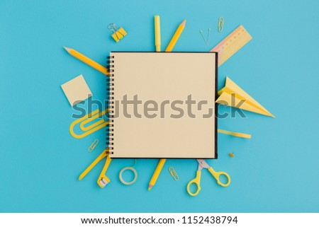 School notebook and various stationery. Back to school concept. Creative flat lay desk. #1152438794