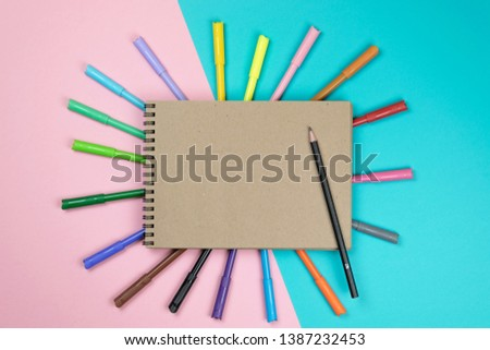 School notebook and various stationery. Back to school concept. Multicolored background. #1387232453