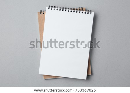 school notebook on a gray background, spiral notepad on a table