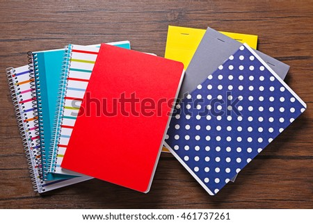 School notebooks on wooden background