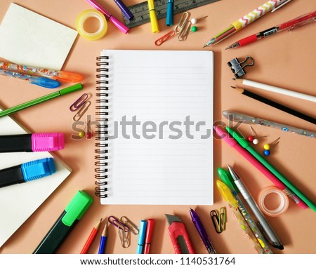 School office supplies on a desk with copy space. Back to school concept.