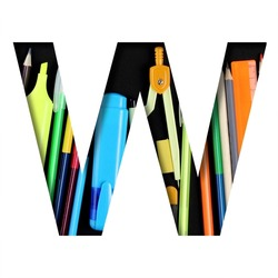 School or office supplies font. The letter W cut out of paper on a background of a set of stationery for school, study or office with black backdrop. Decorative alphabet, font collection.