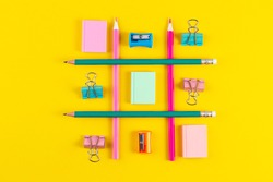 School pencils on yellow background with School supplies. Minimal concept art. Creative flat lay top view back to school concept with stationery