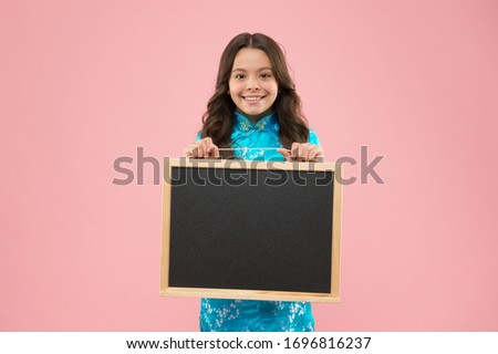 School publicity. Happy kid hold blackboard pink background. Little child smile with tidy publicity board. Advertising and publicity. Publicity agency. Back to school marketing campaign, copy space.