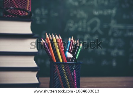 school stationary on wooden table - Shutterstock ID 1084883813