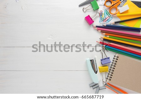 School stationery and office tools on wood table. Foto stock ©