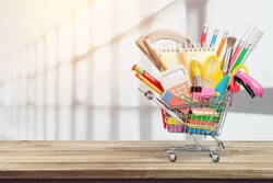 School stationery composition in shopping cart