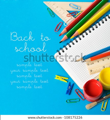School stationery on the blue with copy space