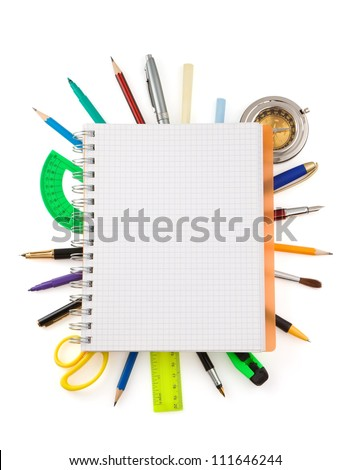 school supplies and checked notebook isolated on white background