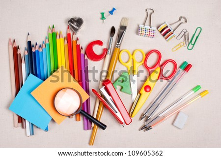 School supplies are on the table cloth