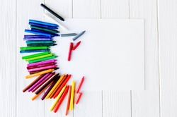 School supplies for drawing on the table: paper and crayons