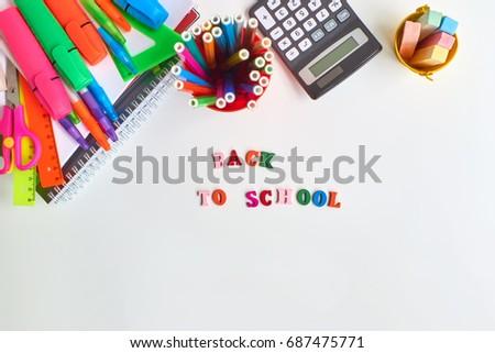 School supplies frame on a light background