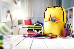 School supplies on a wooden table in a warm interior