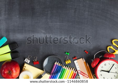 School supplies on black board background. Back to school concept #1146860858