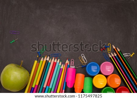 School supplies on blackboard background ready for your design. #1175497825