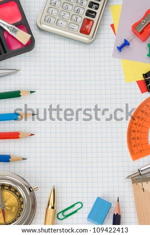school supplies on  checked notebook paper