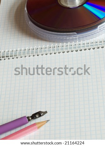 school supplies on squared sheet of a copybook