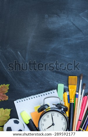 School supplies on the background of the teachers' board - Shutterstock ID 289592177