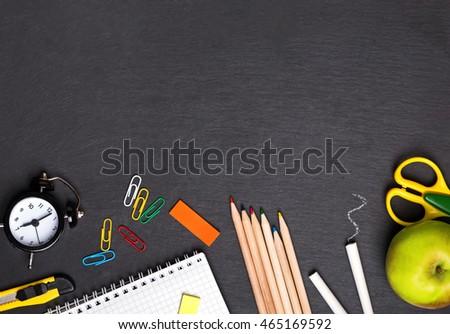 School supplies on the blackboard, top view #465169592