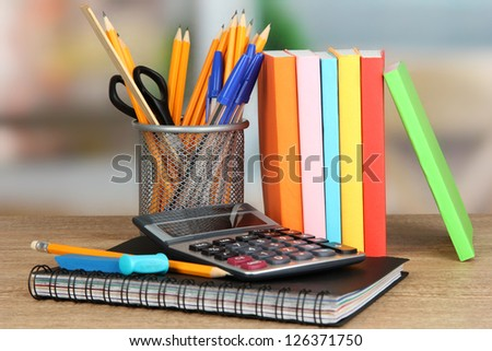 School supplies on wooden table