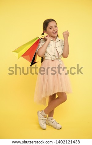 School supplies shopping list. Back to school season great time to teach budgeting basics children. Prepare for school season buy supplies stationery clothes in advance. Girl carries shopping bags.