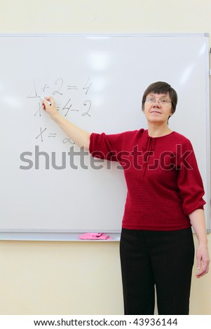 school teacher at the whiteboard