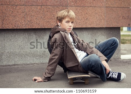 School teen with schoolbag and skateboard, day