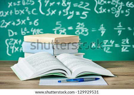 school textbooks on a desk in...