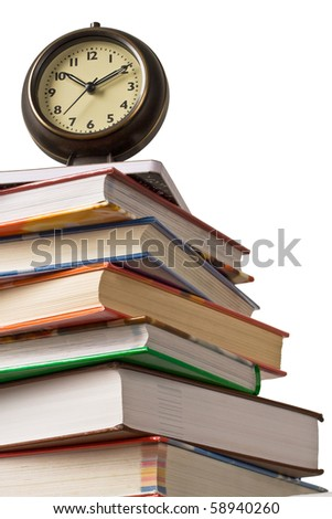 School time. Alarm clock sitting on top of a stack of books.  Concept of education.
