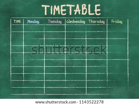 school timetable or class schedule on green classroom chalkboard