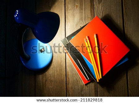 School tools and the fixture. On a wooden background.