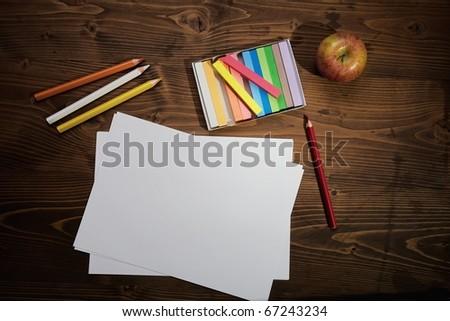 School tools on wooden board