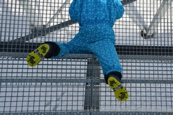 school trip, falling from metal stairs in winter glides dangerously. a little boy in winter boots fell and lay injured on the stairs. legs broken twisted danger of falling, stun baby, children blue