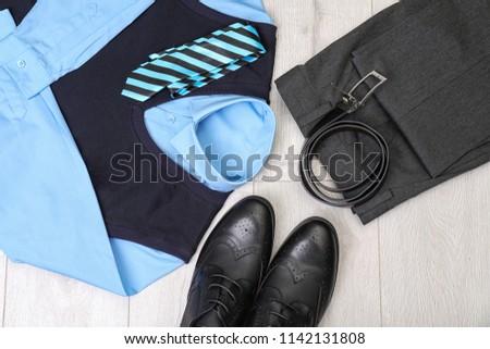 School uniform for boy on laminate, top view