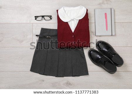 School uniform for girl on laminate, top view