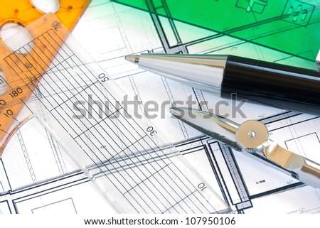 School utensils - rules, pens on design paper